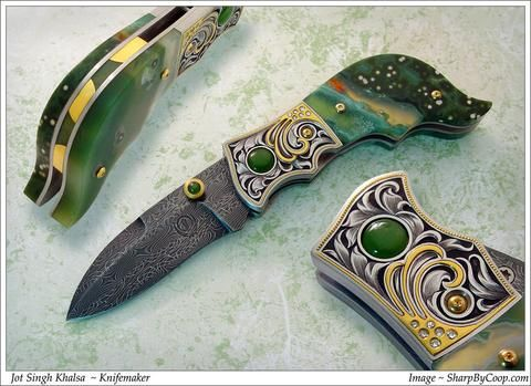 Engraved Jasper folding knife  Ocean jasper (natural mineral from Madagascar) handled liner lock folding knife. Jade accents. Engraving, gold inlay and 12 full cut diamonds. Carved, gold overlaid and inlaid spine with ocean jasper. Composite pattern nickel damascus steel blade.   #KhalsaKirpans . . . #Khalsa #Punjab #Singh #Kaur #Sikh #Sikhism  #Turban #Beard #PunjabiWedding #Punjabi #Sardar #Sardari #Sardarni #SikhWedding #Artisan #Sword #Dagger #Blade #BladeSmith #BladeArt #Art #Knife…