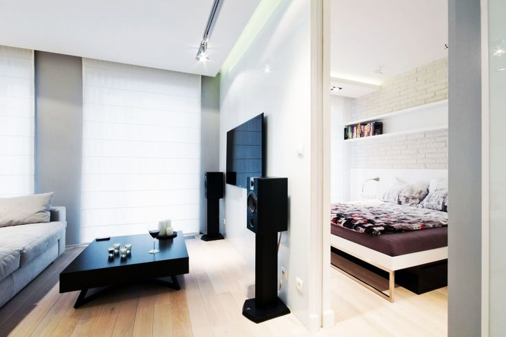 Apartment, Minimalist And Modern Bedroom Behind The Living Room Wall At White Water Apartment Decorated With Mini Home Theatre: Stylish and ...