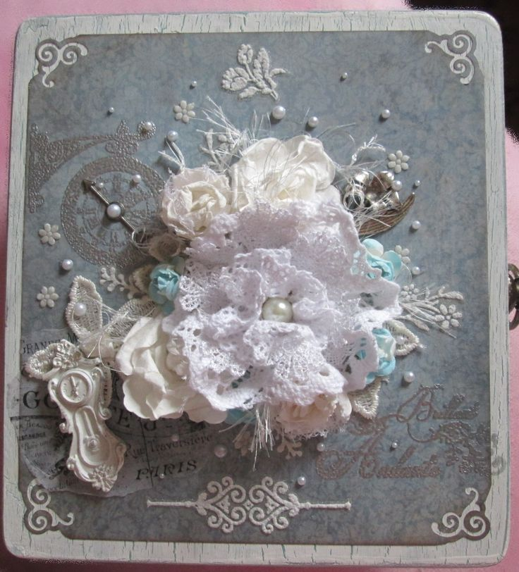 White wooden box with patina, decorating scrapbook paper and lace, paper flowers, resin and metal ornaments