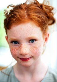 red hair and red freckles. WHEN I WAS A VERY SMALL CHILD, MY GRANDMOTHER WOULD TELL US HOW LUCKY WE WERE TO HAVE SO MANY KISSES FROM ANGELS THAT EVERYONE COULD SEE.