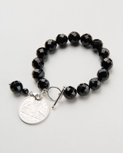FACETED ONYX COIN BAR BRACELET $76.00  These stunning black onyx stones are faceted and polished beads reflecting the light with a beautiful sparkle. The bracelet also features two round sterling silver beads and a single Australian Shilling . A timeless, classic piece guaranteed to accent any outfit beautifully. Match them with a stunning set of our Faceted Onyx Drop earrings.