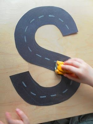 Driving a toy car on S Street. You could create a whole alphabet for your child to drive their toys cars on. A great way to learn letter shapes. from @Abby Jacobsma Butterfly