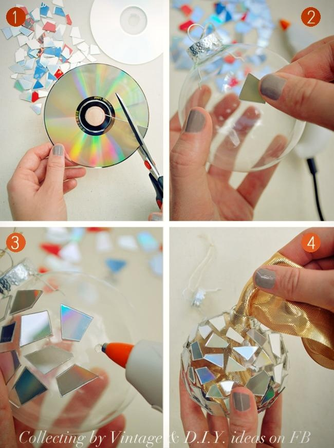 Do-it-yourself tree ornaments    You will need a transparent tree decoration (globe) or any transparent sphere. An old CD, scissors and glue.