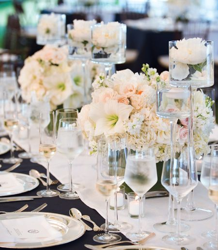 low glass cube vases with a mix of hydrangea, peonies, and tulips in ivory, and bright and light pinks