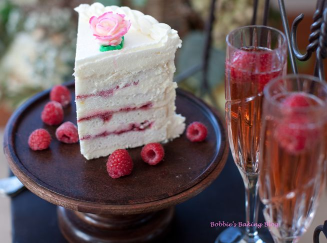 white velvet cake with raspberry filling and white chocolate frosting