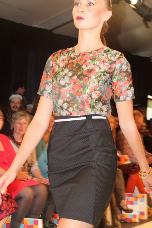 Millicent - This collection is a flirty-yet-corporate style. High-waisted skirts in sorbet colours matched with prim neatly tucked-in shirts. Hemlines were just above the knee and thin belts accentuated waists to create a polished look.