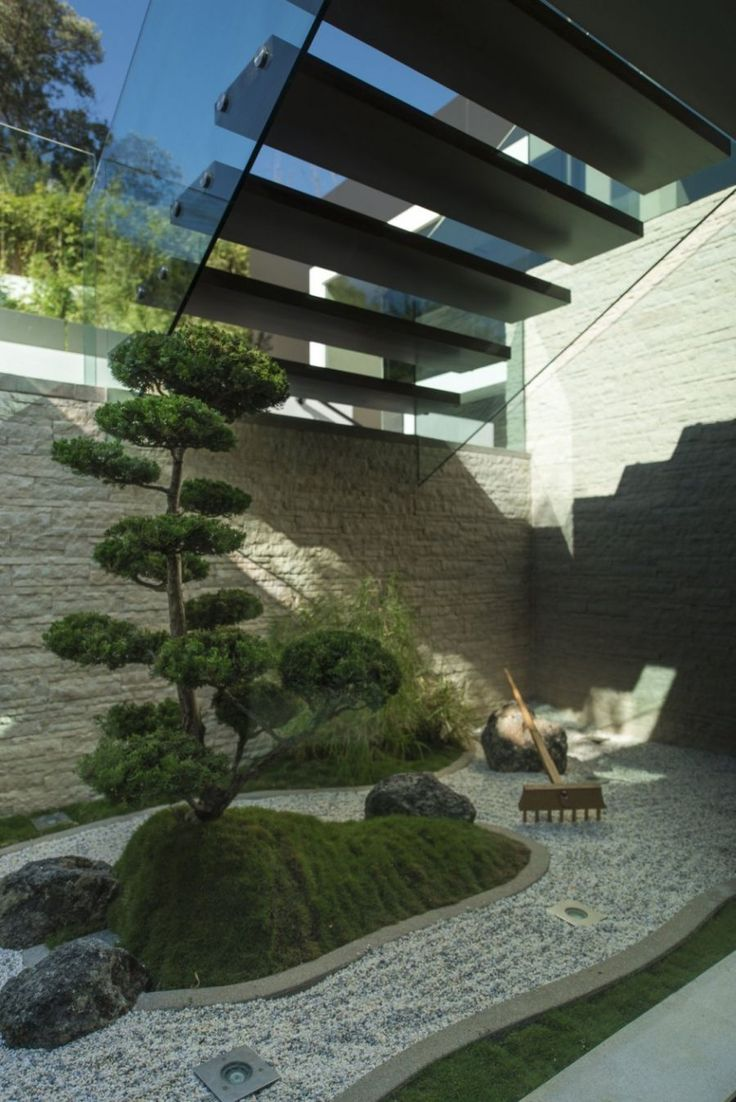 Floating staircase above an interior landscape