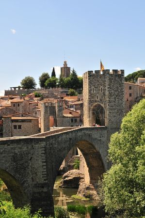 An early-Medieval fortified masonry bridge crossing the river into the town of Besalu. Catalonia