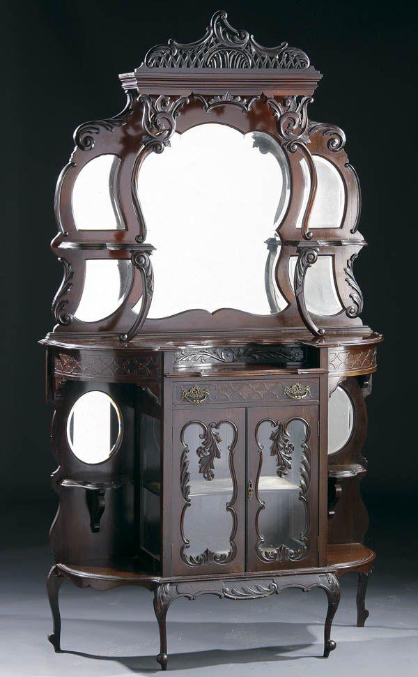 A Rococo Revival Carved Mahogany Etegere, 19th century.