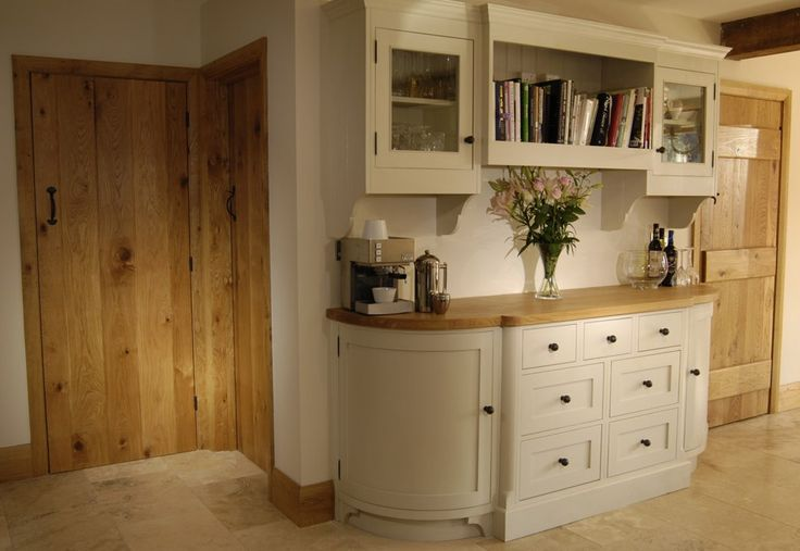 Great use of a short run of wall space. Fab curved base cabinets. The final effect is that of a modern dresser.