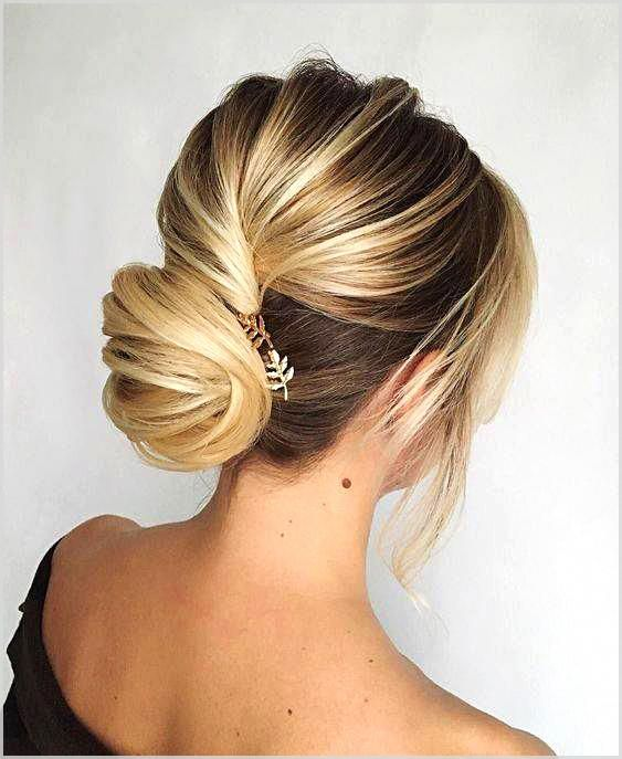 The Low Chignon can be a glossy bridal hair messy bun which seems incredibly wonderful on bridesmaid as well.