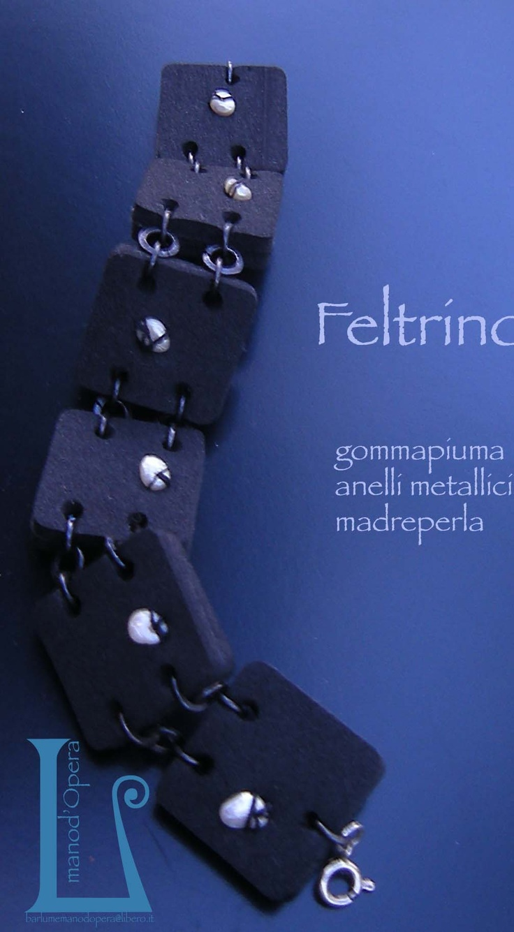 Black foam rubber with mother of pearls applications. Handmade by BarlumeManod'Opera.