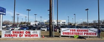 "Subaru of Wichita outmaneuvers local union attack outside dealership with a ""Shame on Subaru of Wichita"" sign legally placed on the highway right-of-way in front of dealership. The dealership responded with its own sign, turning the union's charge into one of ""having unbeatable prices."" Their counter is clearly resonating with consumers! https://www.facebook.com/subaruofwichita"