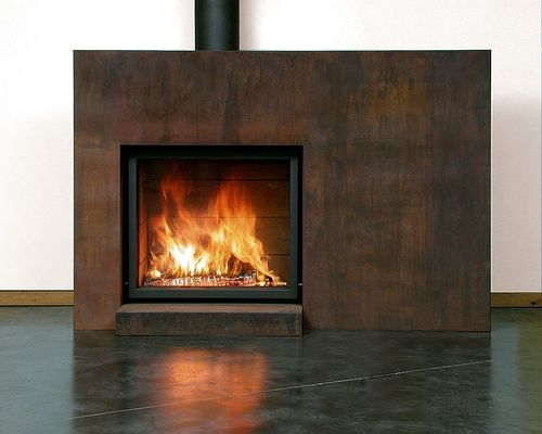 Corten steel fireplace w large chunk of planed back old weathered timber for mantle