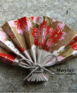 Origami fan with pink and red flowers.