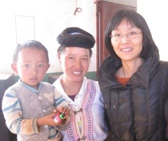 Faith Zhou with the minister's wife and child.