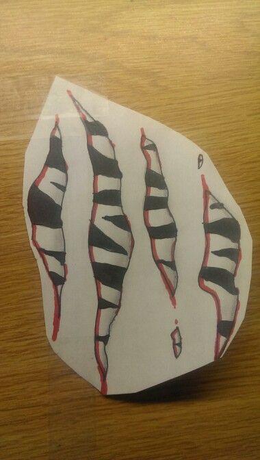 Tiger stripes tattoo scratches