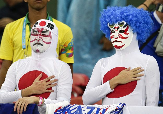 Showing reverence, but still very pumped. | Japan Has The Best Fans At The World Cup