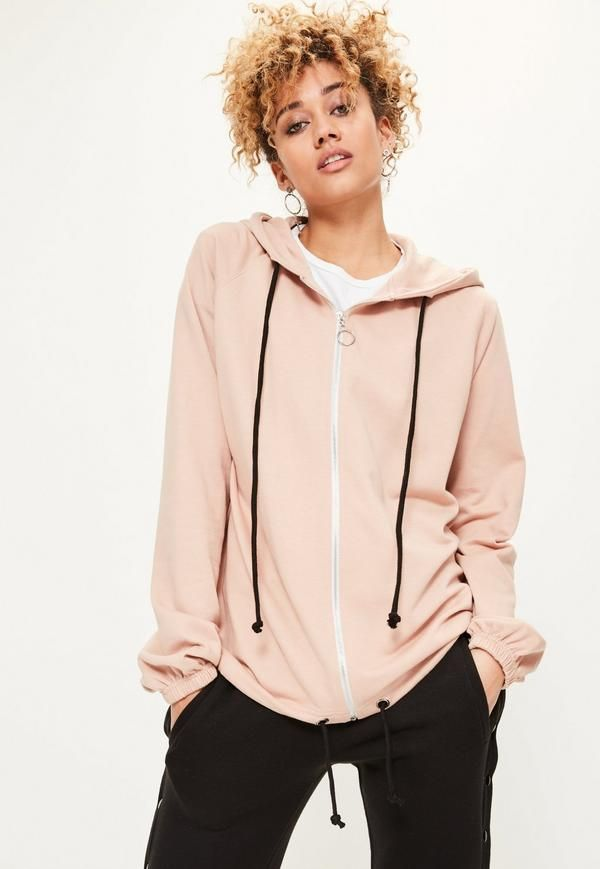 Take it to the street and work the sports luxe look in this oversized zip through hoodie in a neutral nude hue.