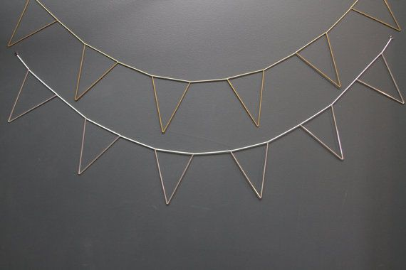 One 4 foot (122cm) long geometric garland based on traditional Scandinavian himmeli mobiles. Each garland comes with 6 pennant flags made from