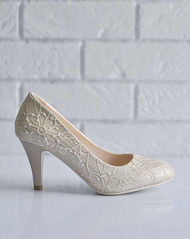 Свадебные туфли: F210-S06 - http://vbelom.ru/catalog/svadebnye-tufli-f210-s06/ Замечательные свадебные туфли на каблуке.  Туфли великолепного цвета айвори, декорированы изящным кружевом. С устойчивым каблуком и закругленным мысом. Послужат прекрасным дополнением, как к свадебному плать�