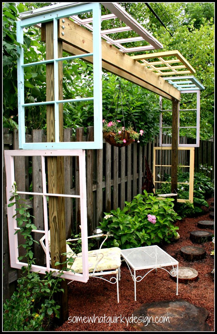Old window pergola by Somewhat Quirky  Garden junk at its finest… this pergola made from old windows is a true garden feature winner! Can you imagine vines winding through all the frames?