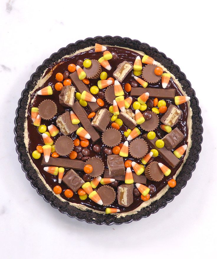This candy-studded tart is like a giant homemade Reese's cup, complete with Kit Kats, Candy Corn, and Reese's Pieces, too. It's an absolute must if you're hosting a party this year, or for bringing to your co-workers as a sweet and festive treat.