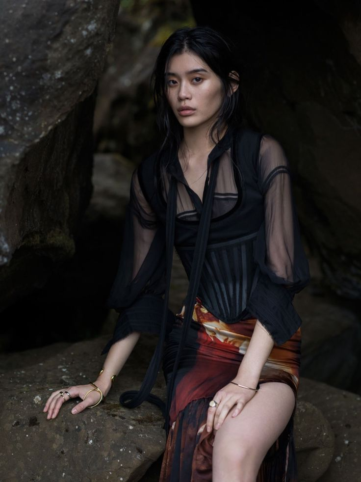 Ming Xi graces the pages of Vogue China's January 2016 in a dramatic outdoor setting, shot by Gilles Bensimon