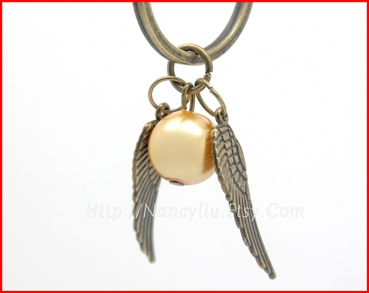 It would be easy enough to DIY if you can find the charms. Sale---Harry Potter Enchanted Golden Snitch Pendant Keychain,Steampunk Flying Wings Keychain Key Ring Keyring in Antique Bronze--45K122. $2.96, via Etsy.