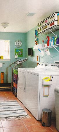 What a great use of space- laundry room and workout room!