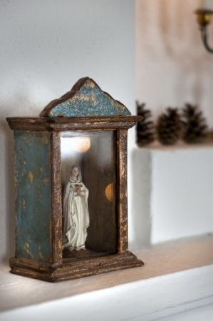 SFH Adds: A stunning wooden painted box to enshrine the madonna. It must be very special standing directly in front of it.