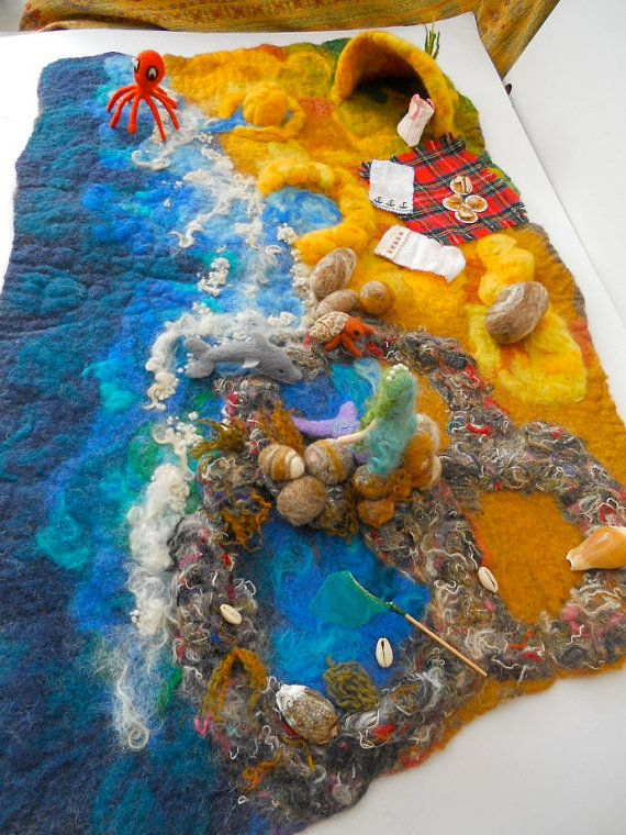A Beach scape 28 x 18 inches, with ;    fixed items  3 rock pools, ,a sand castle with a moat, a sand pool, a cave, seaweed and sea shells    mobile
