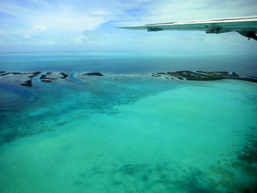 The stunning view of Belize's islands from our tiny plane. #travel #belize #belize vacations