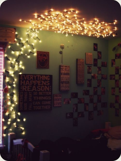 string lights pinned to wall and ceiling lanterns