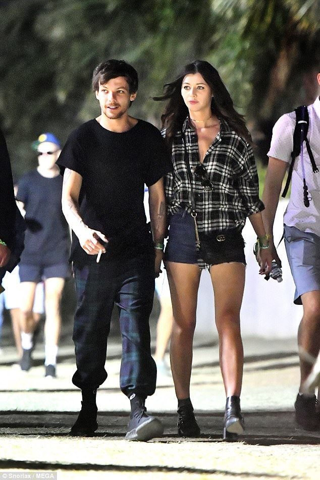 Back on track: Louis Tomlinson and his girlfriend Eleanor Calder went hand-in-hand as they celebrated in style at Coachella Festival in Indio, California on Sunday night
