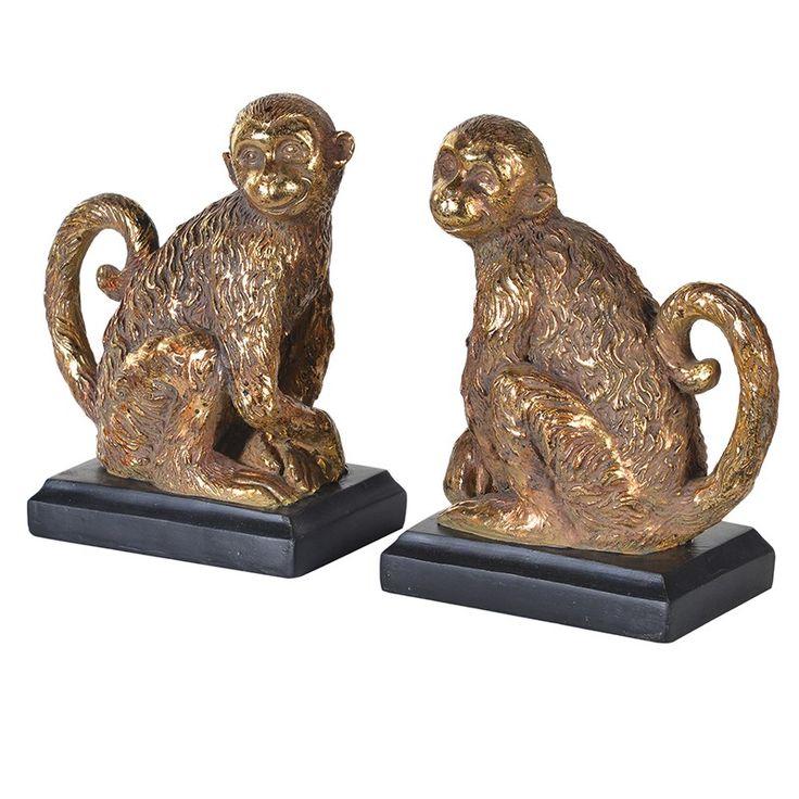 Dekorativt bokstöd i form av sittande apor. Tillverkade i guldbrons konstmassa. Sitter på svarta socklar. Levereras som ett par, en höger och en vänster