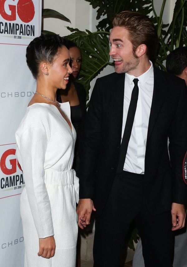 Robert Pattinson & FKA Twigs so, this is the first pic where he and she are smiling at each other. all others he's the one smiling at her