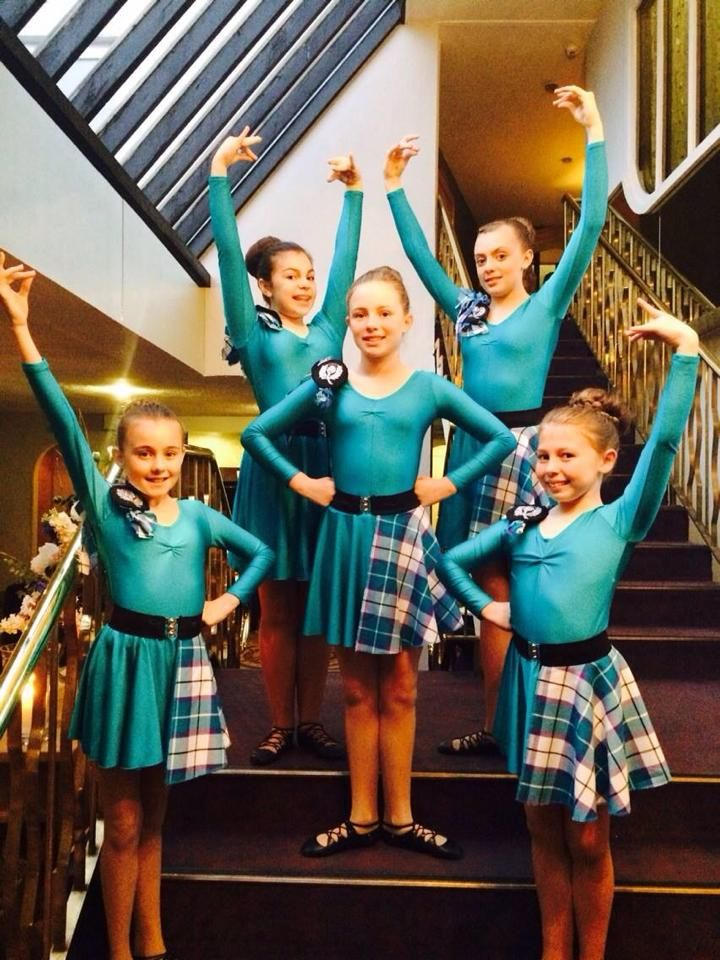 Sollus Highland Dancers in Bonnie Aqua accented outfits to perform at a wedding.