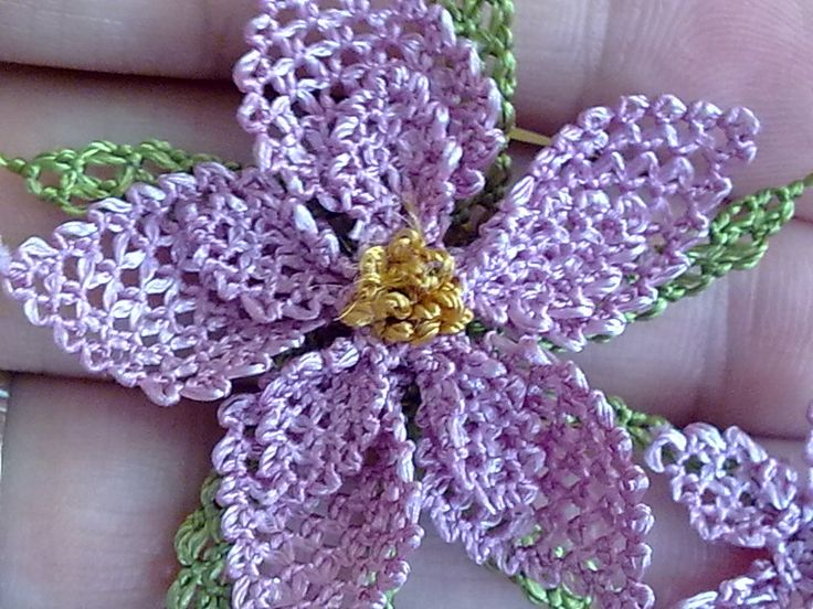 handmade flowers tutorial - basically made up of picot stitches, done with a needle; no pattern, strictly a picture tutorial
