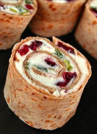 Cranberry Feta Pinwheels. Tortillas, dried cranberries, green onions, cream cheese and feta (I used goat cheese instead of feta) and added toasted walnuts). Easy and delish.  Would be festive for Christmas made with spinach tortilla.