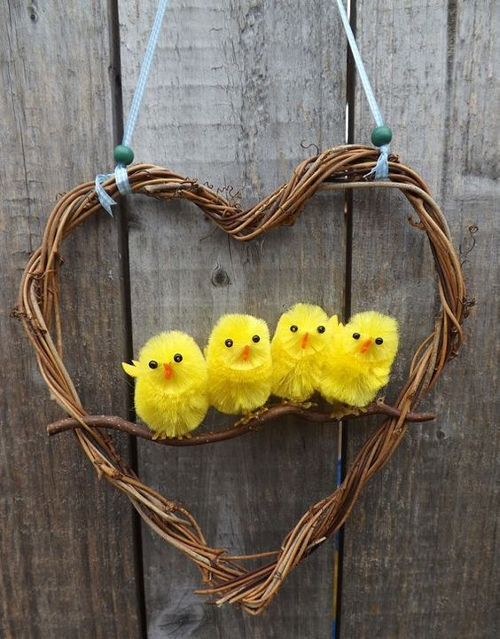 Super cute and fun Easter wreath.  Four little chicks inside a vine covered heart shaped wreath.  Measurements: 20cm high 19cm wide.  The wreath is: