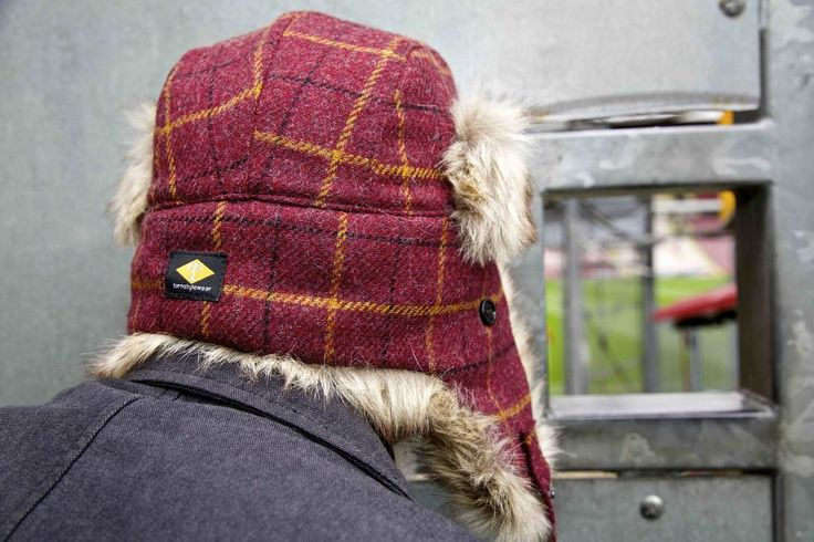 Trapper hat. Our super warm and cosy trapper hat in bespoke claret and amber tweed. With quilted lining and premium faux fur trim. turnstylewear.com
