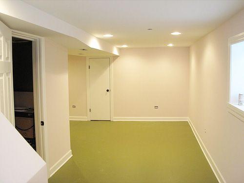 painted floors, recessed lighting, black hardware basement potential from www.makingitlovely.com