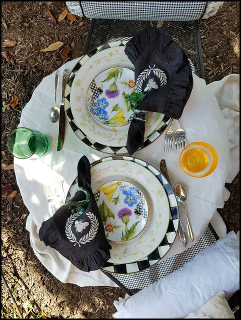 A beautiful tablescape with a lovely mix of florals and checks is perfect for an afternoon sip in the garden.