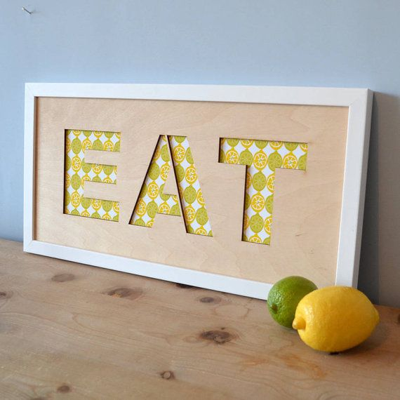 A colourful kitchen addition - plywood lasercut wall art with a pattern choice of lemons/limes, pears or pineapples