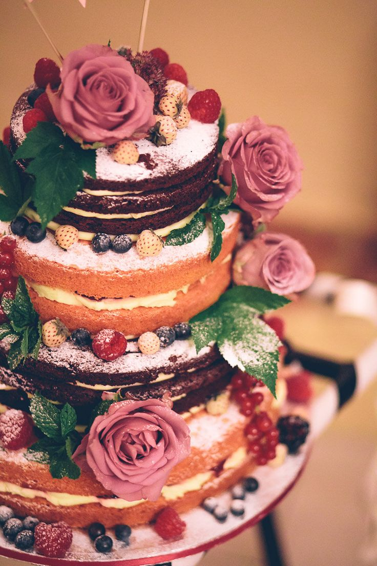 Different flavoured naked cakes - Image by Story & Colour - Bride in Tea Length Lace Justin Alexander Dress with birdcage veil & Rachel Simpson Shoes. Bridesmaid in Hobbs navy dress for a rustic barn wedding with berry blooms, naked cake & nautical theme.