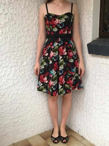 Floral Alannah Hill dress. Size 8. Red and blue rose print Alannah Hill dress. Size 8 with pockets and bow on front. Exposed zip back. Adjustable ribbon straps. One strap is slightly pulled near where it joins - see pictures. Cotton silk with acetate lining.