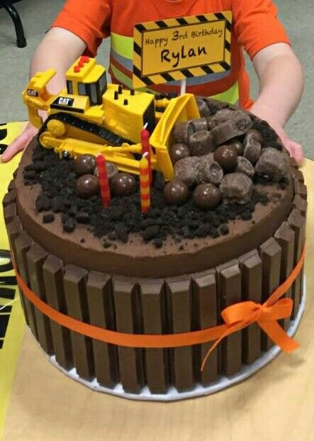 Excavator Chocolate Cake: chocolate cake with raspberry chocolate ganache and chocolate buttercream frosting.