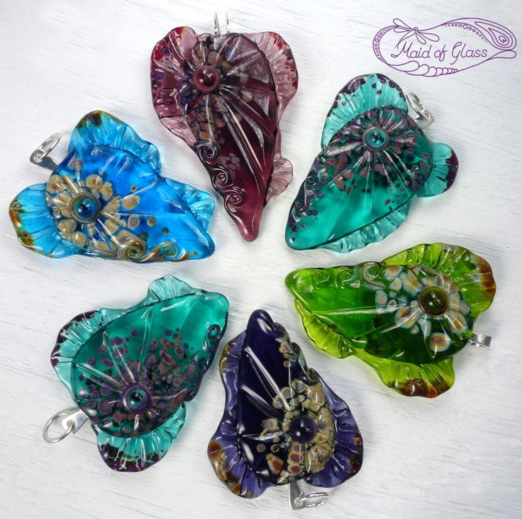 All the pretty colours! My mermaids heart lampwork glass pendants are avaliable in my online store www.MaidofGlass.co.uk