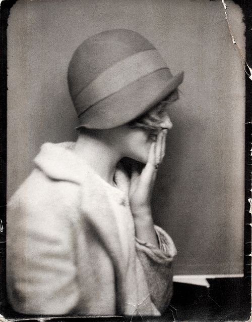 historiful:  A young woman giggling, date unknown.                                                                                                                                                      Plus
